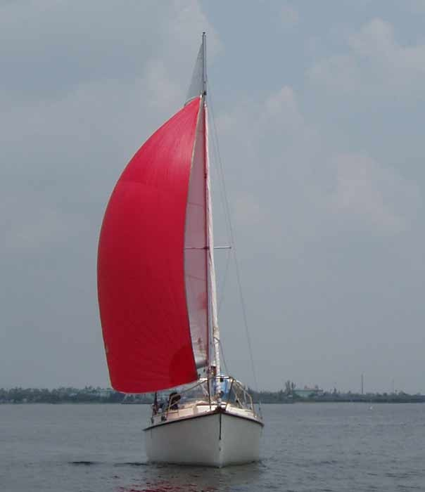 Com-Pac Eclipse Under Spinnaker - Photo of Com-Pac Eclipse sail boat
