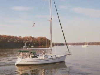 ComPac 35 motoring in calm water - Photo of Com-Pac 35 sail boat